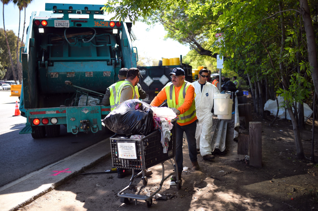 Emptying Homeless Encampments -Tells homeless people that everything they have and are is worthless trash